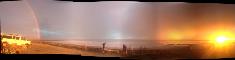 sunsetting to the west rainbow to the east
